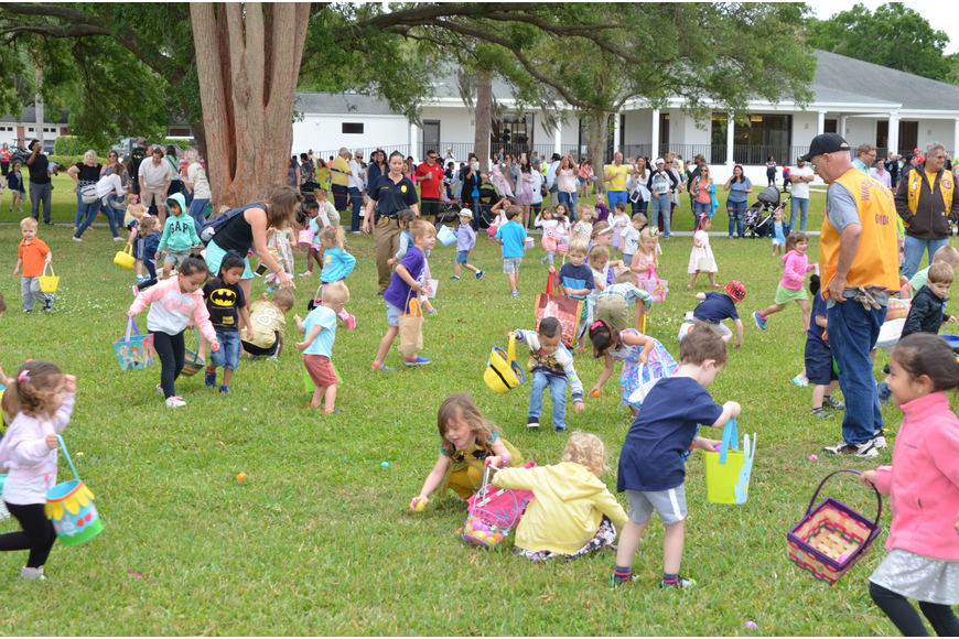 Three- and 4-year-olds race toward the eggs.
