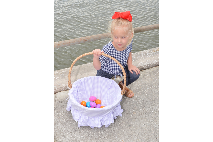 McKinley Sims, 3, proudly displays her basket of eggs.