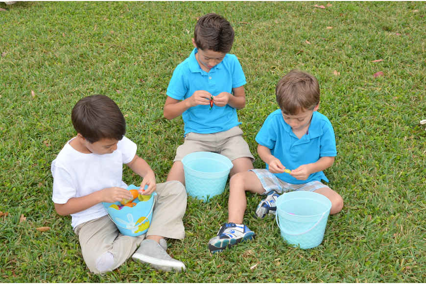 Miles Dombrowski, left, Mason Houghton and Derek Houghton inspect the contents of their eggs.