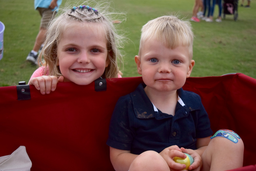 Emma and Bradley Gagliano showed off their little red wagon.