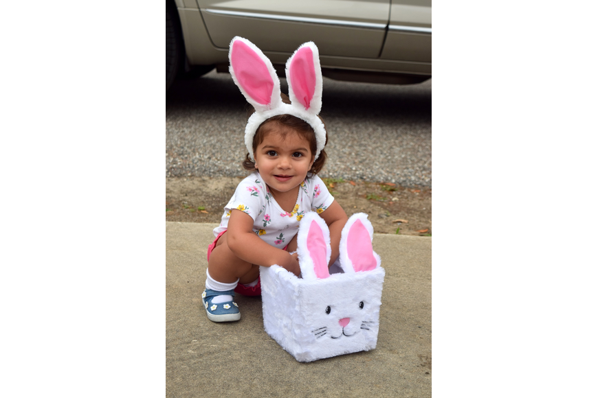 Bella Silva got into the Easter spirit with her ears and basket.