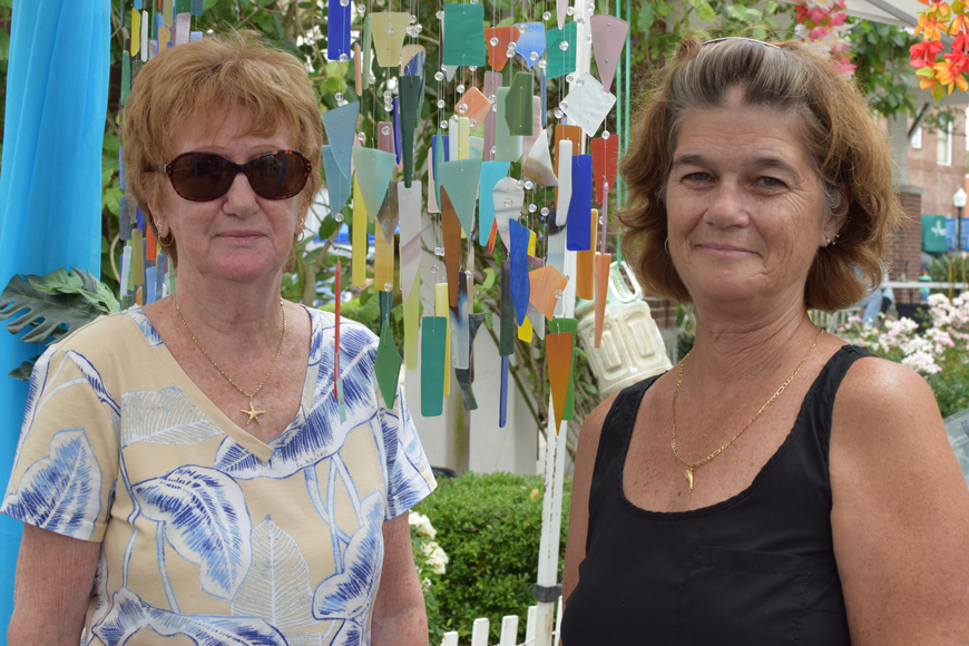 Colorful wind chimes made from recycled stained glass were sold by Carol Frey (right), and Terri Cosner – the mother-daughter team behind Waters Edge Creation.