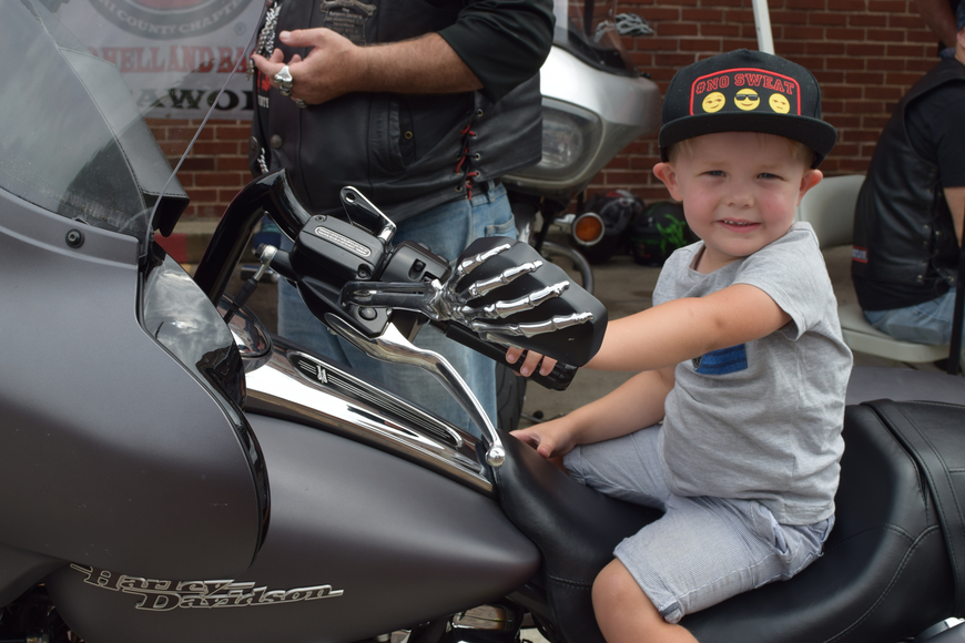 Children took the opportunity to feel what it's like to hop on a motorcycle courtesy of the Bikers Against Child Abuse organization.