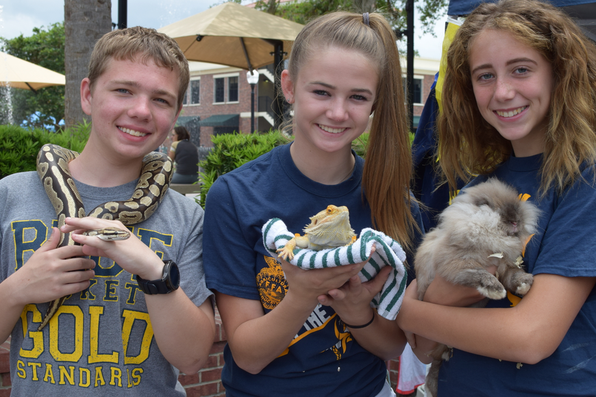 Justin Petrak, Jessica Stroup and Mikayla Blosmo from West Orange High School's Future Farmers of America chapter brought live reptiles and animals to educate children.