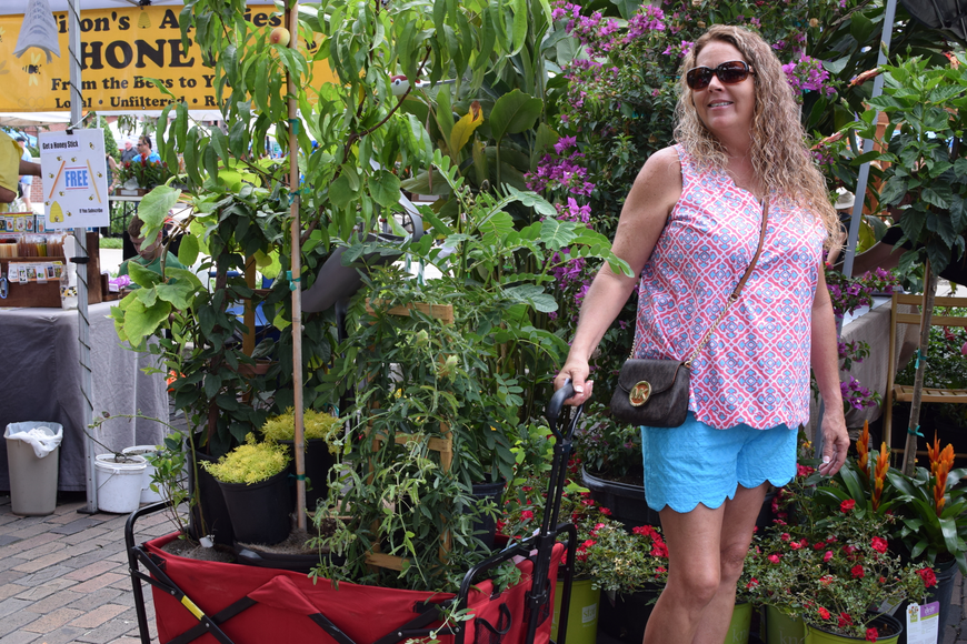 Several attendees splurged on the lovely plants and flowers and brought wagons to neatly pile their purchases, such as Tricia hill from Clermont.