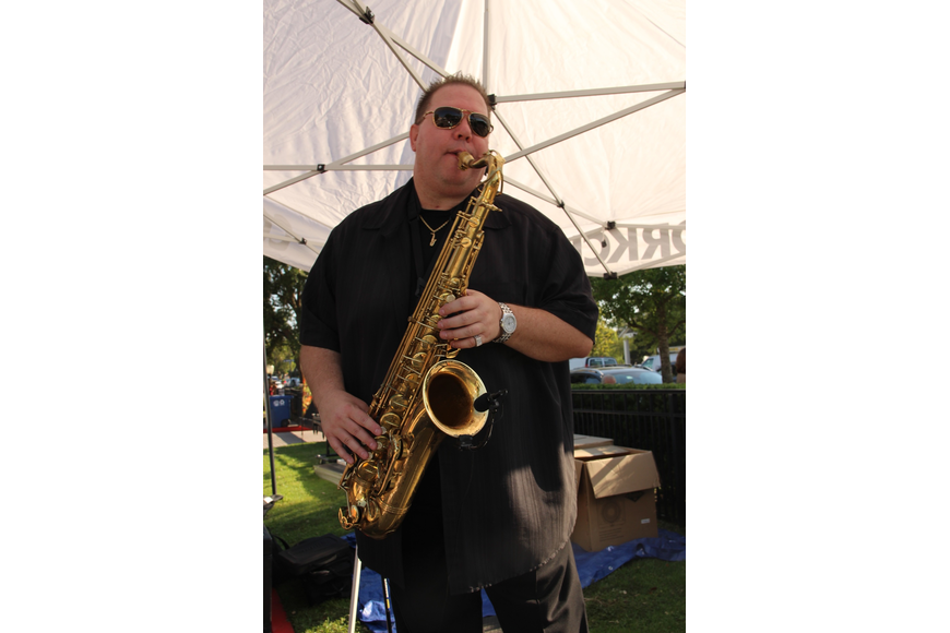 Johnny Magnuson, also known as Johnny Mag Sax, played tunes to the gathered crowd.