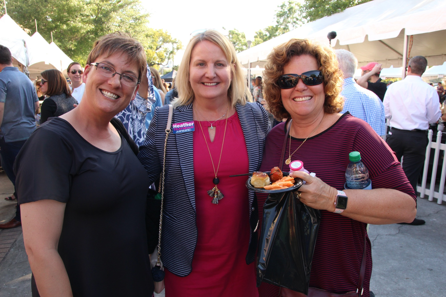 Donna Batton, District 1 school board candidate Heather Traynham and Brenda Caldwell talked for some time.