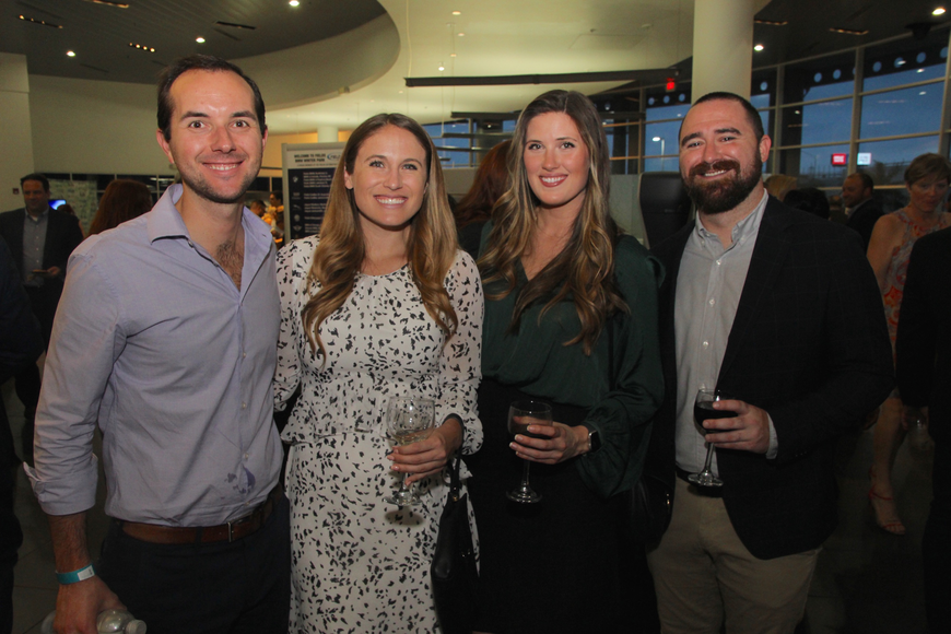 Michael Dymond, Carolyn McDowell, Heather Cunningham and Owen Fasolas grabbed some drinks.