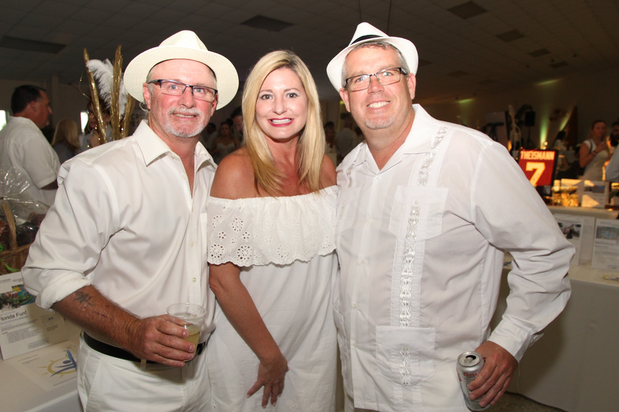 Brad Rose, Susan Henley and Greg Wright showed up to have fun.