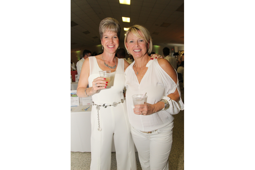 Pam Helbling and Kim Costello wore white well.