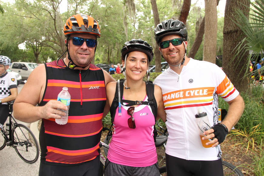 Joe Morris celebrated a successful ride with Kristen and Adam Fisher.