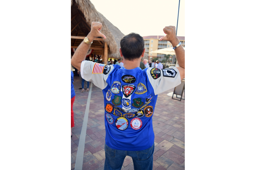 Air Force Maj. Robert Apodaca shows off his U.S. Air Force jersey, decorated in various patches.