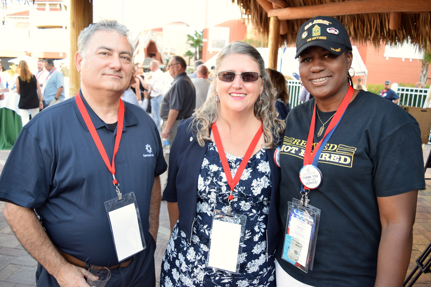 Nef Rodriguez and Anna Tanzilla, representing the Camaraderie Foundation, and retired U.S. Army 1st Sgt. Dee Espeut-Jones enjoyed chatting with each other.