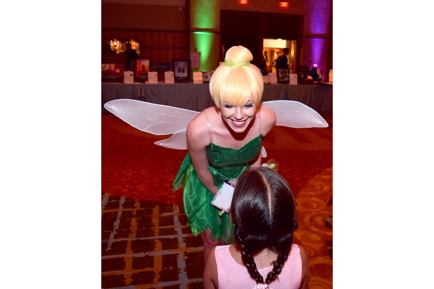 Tinkerbell leans down to talk with one of her biggest fans.