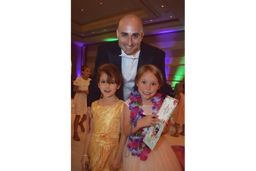 Errol Kareem took daughter Naila and her friend, Harper Campbell, around the dance floor to meet all the princesses.
