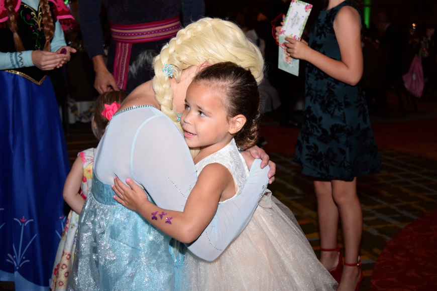 "Amaya Jackson received a hug from Elsa, a ""Frozen"" character."