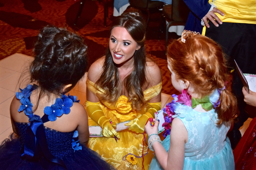 "Belle, from ""Beauty and the Beast,"" was all ears as she chatted with her fans."