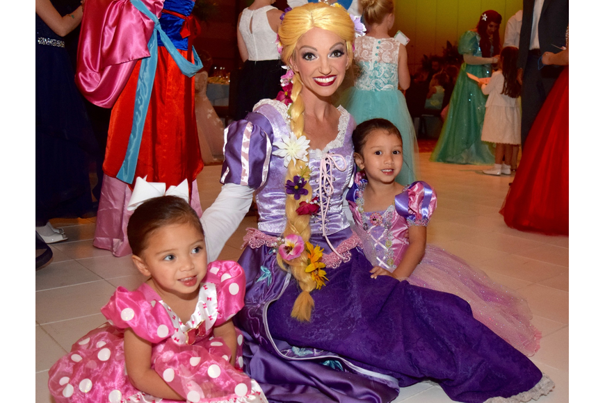 Rapunzel knelt down for a photo with Windermere residents Olivia and Julia Espiritu.