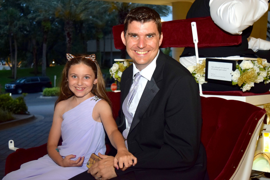 Drew Terrell and daughter Natalia settled in for a horse-and-carriage ride.