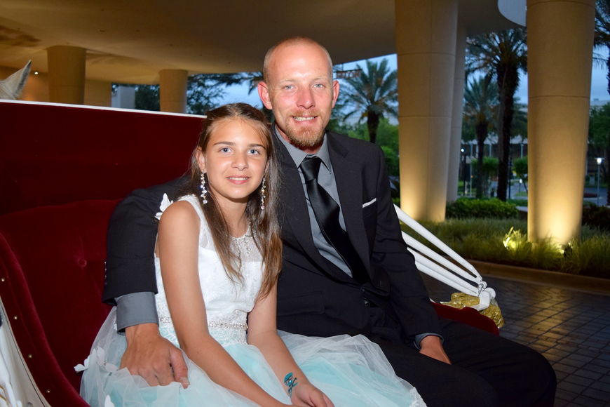 Tyler Chapman and daughter Devlyn were ready to go for a horse-and-carriage ride.