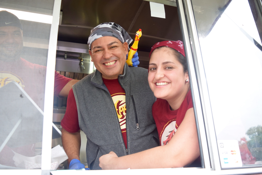 Carlos Arocho and Gloria Sanchez manned the Apps Food Truck with a little help from their goofy coworker and a rubber chicken.