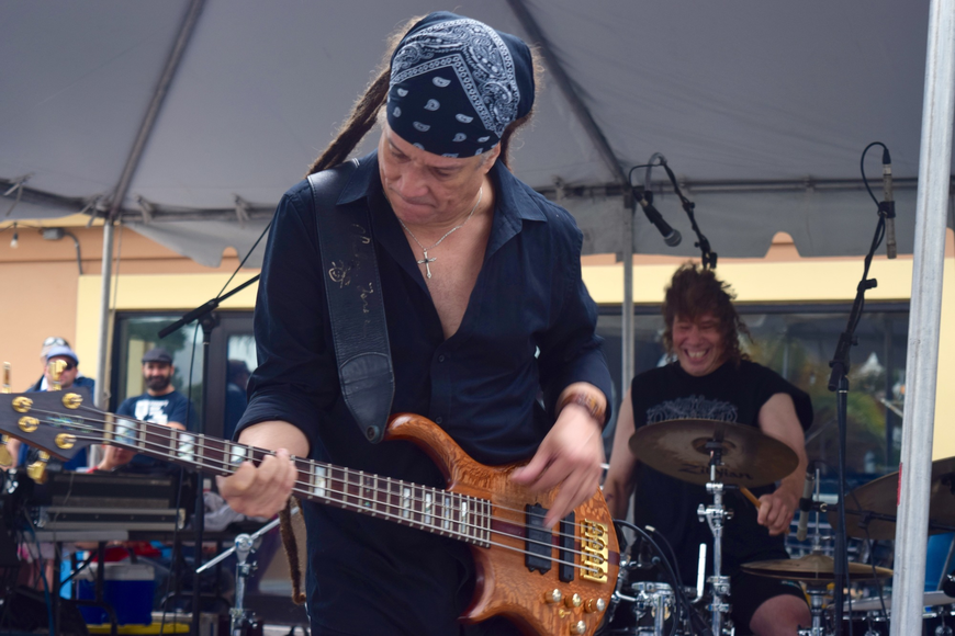 Charlie Torres rocked out on the bass guitar as part of Rick Derringer's band.