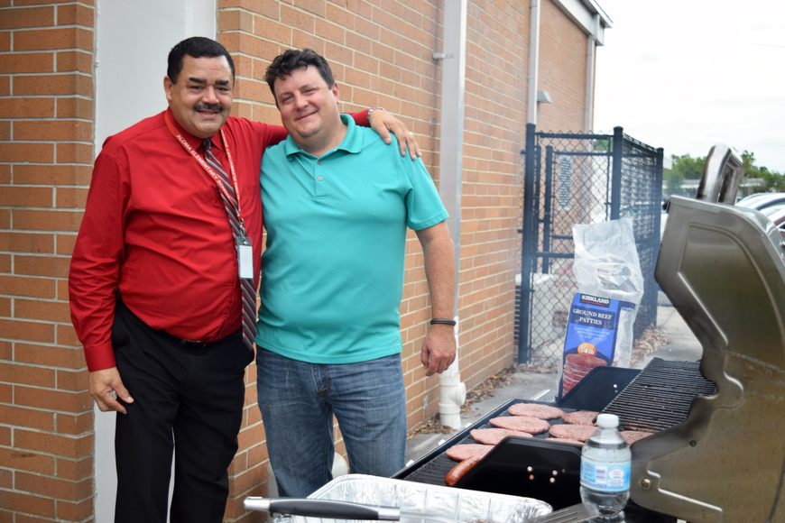 Antonio Payan and Rod Miller grilled up some burgers.