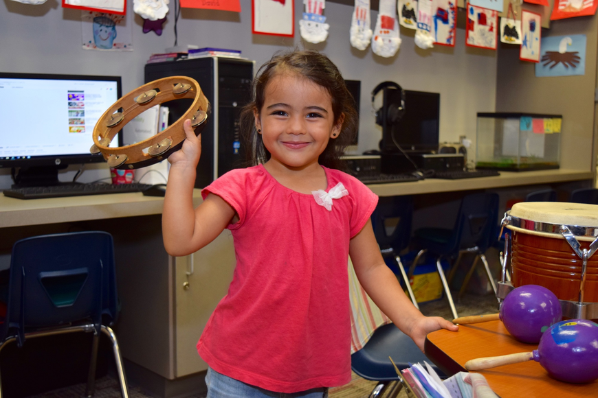 Isabelle Rodriguez proudly held up a tambourine.