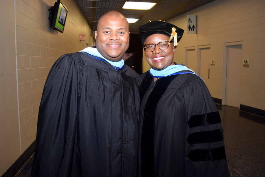 Eric Saxon and Assistant Principal Ava Green were ready to lead the graduates into the arena.