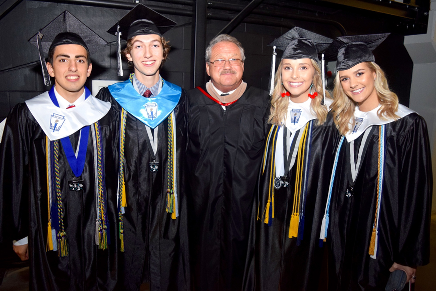 Windermere Mayor Gary Bruhn, center, was all smiles with valedictorian Michael Thomas Russo, salutatorian Mark Daniel Leongomez, student-body president Catherine Jeffers and senior-class president Elizabeth Biro.