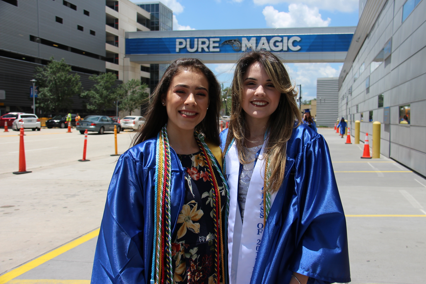 Sophia Belloli, left, and Ariane Machado looked good in their graduation gowns.