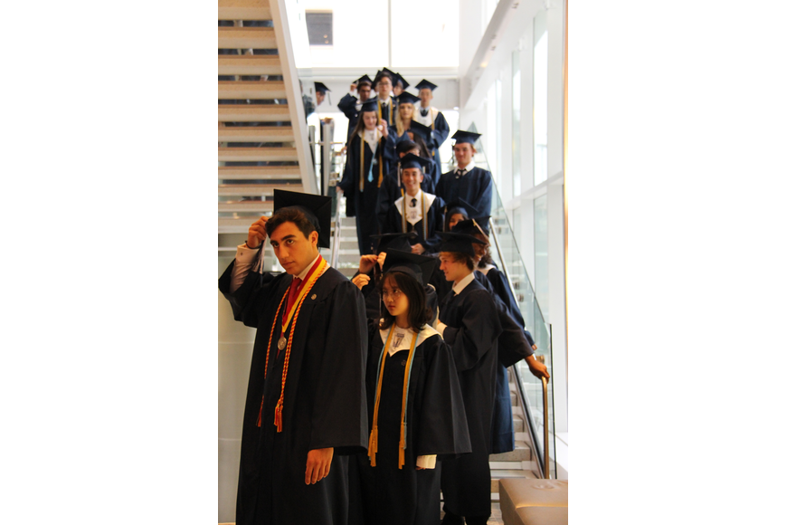 Windermere Preparatory School's class of 2018 descended a stairway as they began the walk for their graduation ceremony.