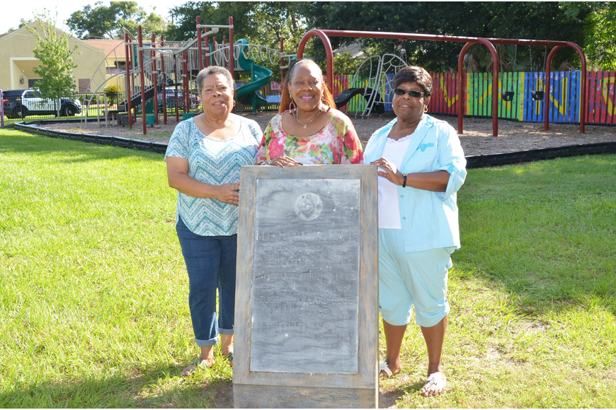 Sisters Betty Wade, left, Barbara Wade Massey and Katherine Wright stand by the dedicated cornerstone of the former Mount Herman Masonic Hall No. 45. The lodge was built on this land. Their mother was a Worthy Matron of the lodge.