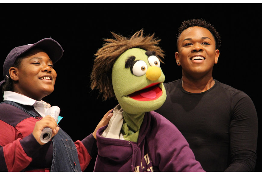 "Shina Mitchell, left, played the role of Gary Coleman and Max Sherman played the character Nicky. The two joined in this scene to sing ""Schadenfreude."""