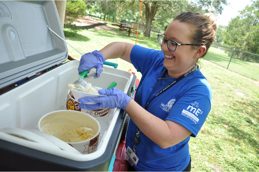 Winter Park's Family Fun coordinator Kelsi Baker scooped ice cream at the event.