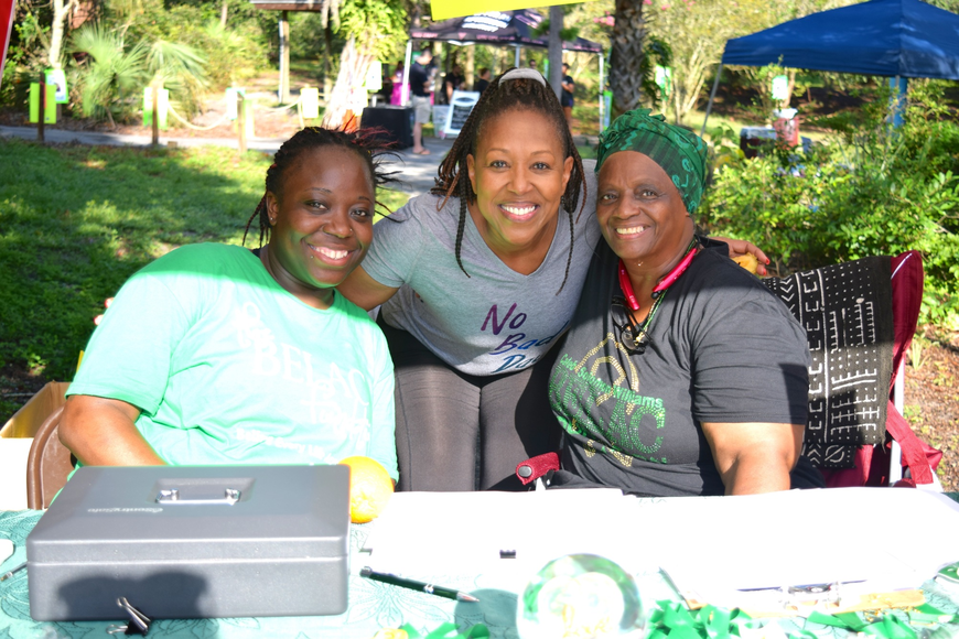 Marlana Francis, Imolé Akinlana and Star 94.5's JoJo O'Neal were all smiles at the registration table.