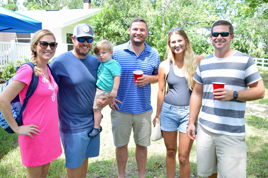 Friends and family came to support Oakes Animal Hospital and celebrate its grand opening. From left: Laura, Ryan and Cole Beck; Justin Oakes; Brett and Katie Claflin.