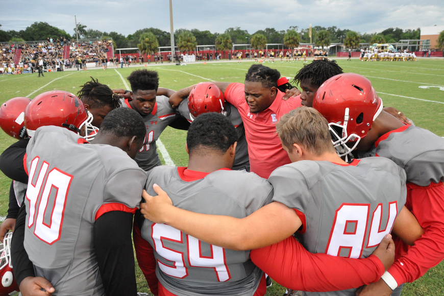 Edgewater football players said a prayer before the Friday night matchup.