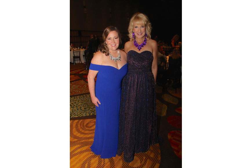 Camaraderie Foundation founder Marnie Waldrop and WESH's Amanda Ober talked after the live auction concluded.