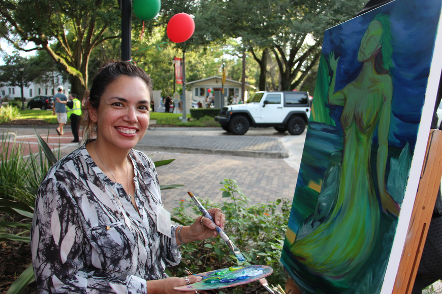 Crystal Dombrosky was all smiles as she worked on her painting.