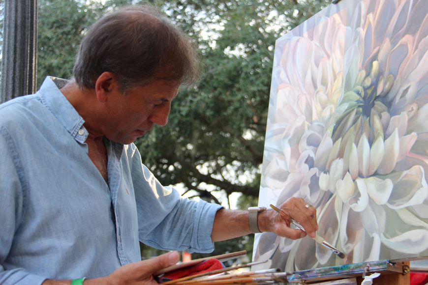 Dr. Terry Mamounas focused on his painting of a white chrysanthemum.