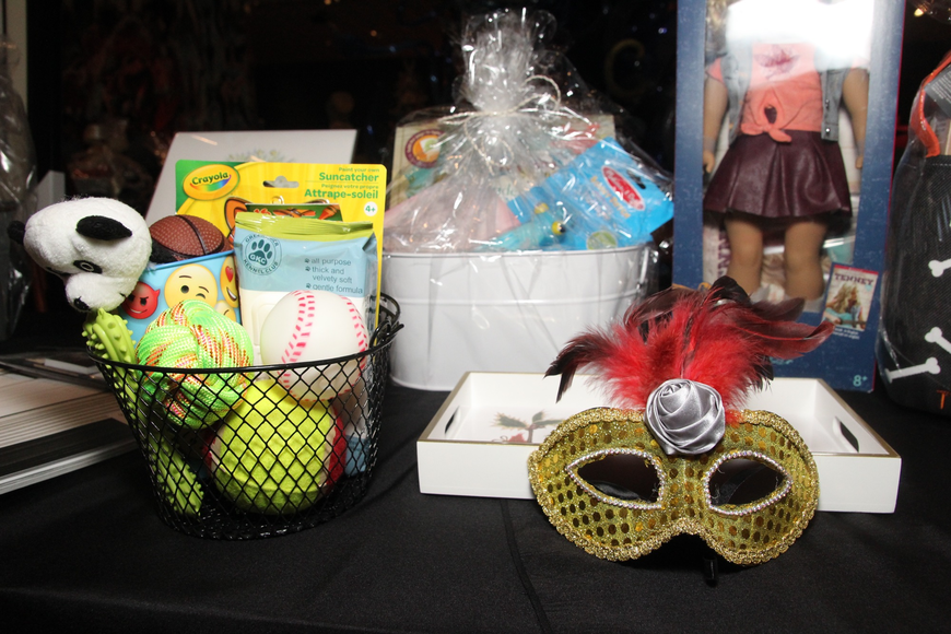 Guests bid on a number of silent auction items after getting drinks.