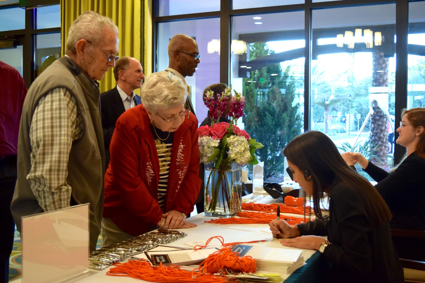 Staff and volunteers helped sign guests in.