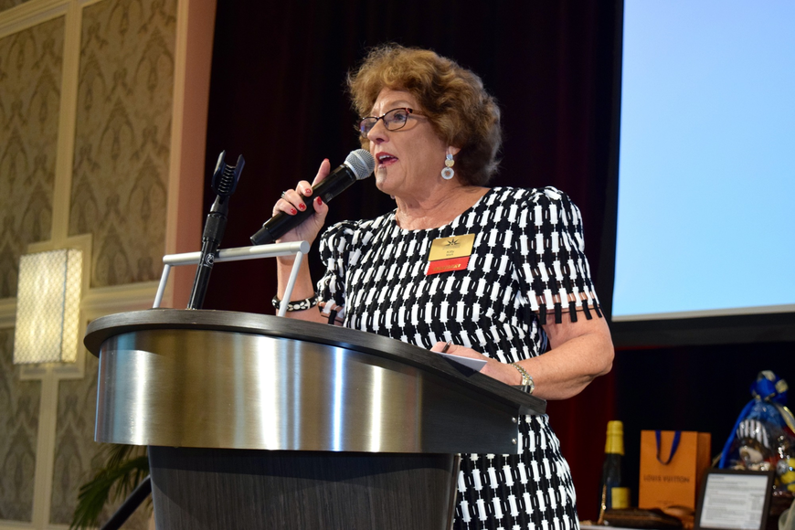 Central Florida Women's League President Kitty Mark welcomed attendees.