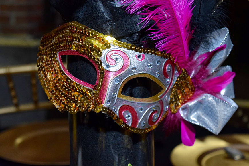 Masks and elaborate centerpieces adorned each table.