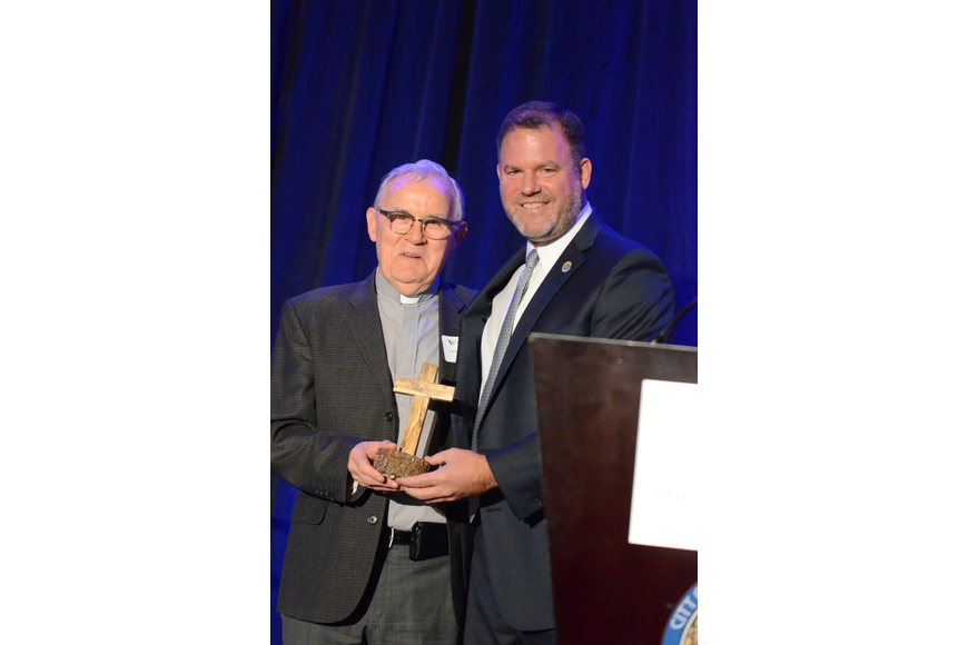The Rev. Richard Walsh was presented with The Mayor's Founders Award by Mayor Steve Leary — acknowledging Walsh's commitment, dedication and actions that build upon the founders' vision for Winter Park.