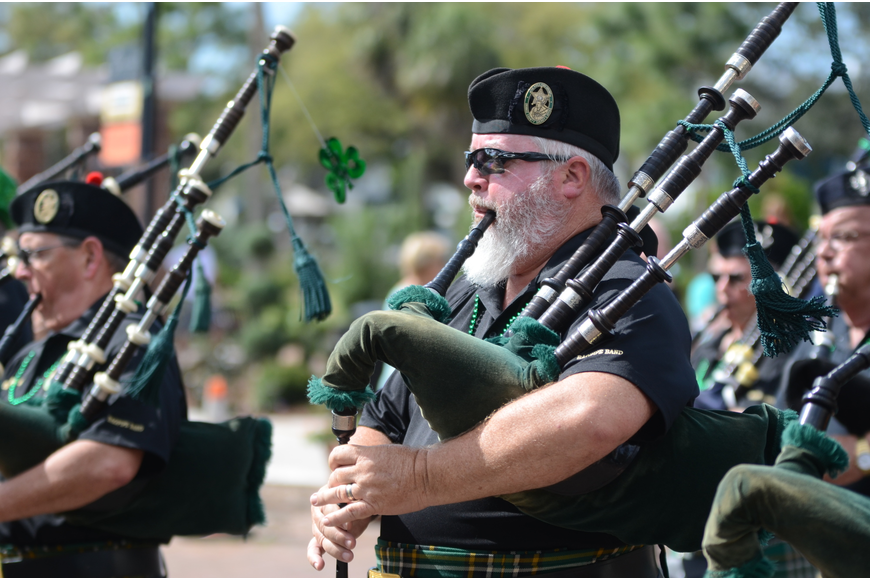 Kevin Rowe of the Pipes and Drums of the Orange County Sheriff's Office played along with the group.
