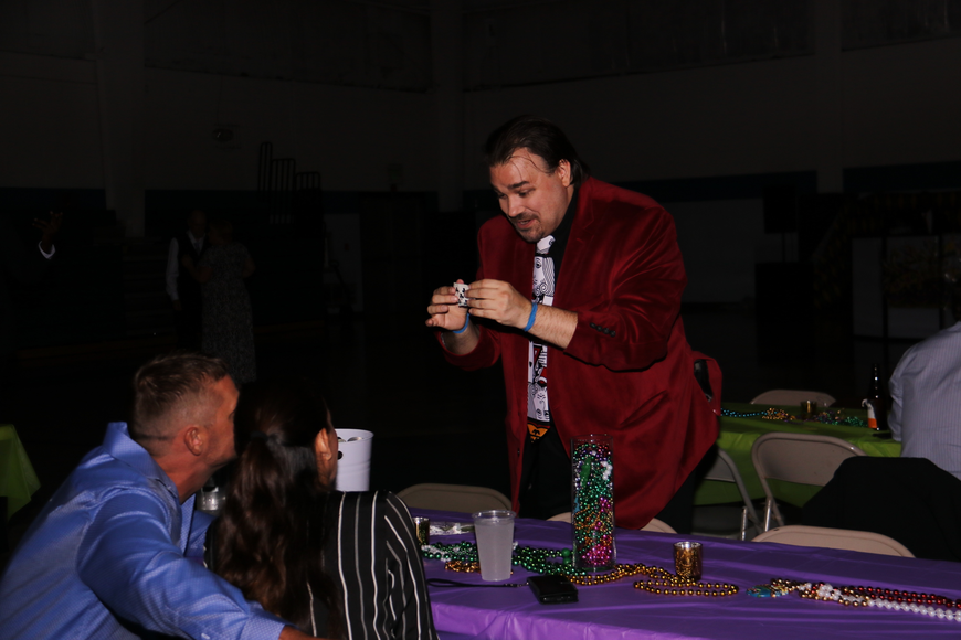 Michael Matson, right, performed close-up magic for prom-goers throughout the night.