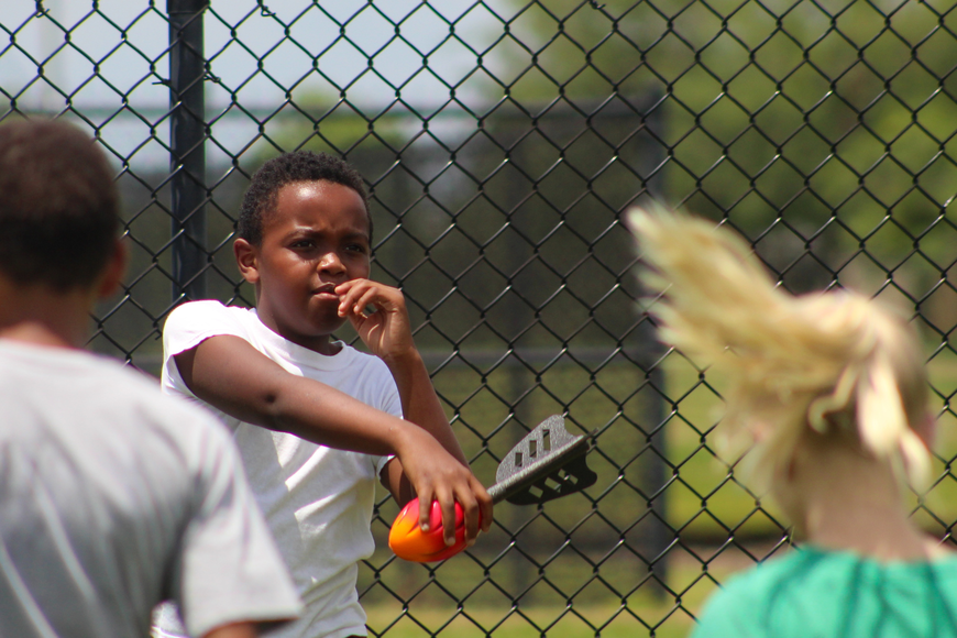 Kelwin Thomas Jr. lines up his shot in the Nerf football throwing competition.