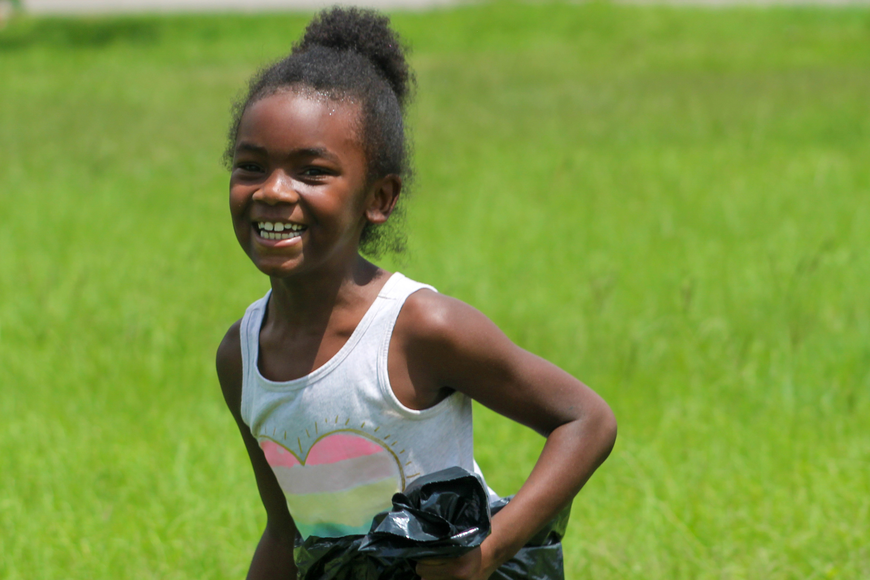 Kamariah Hall laughed as she hopped to the finish line in sack racing.